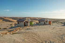 Two Bungalows in front of dunes