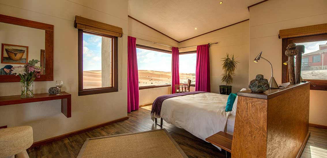 Panoramic view over large Bed in Bungalow